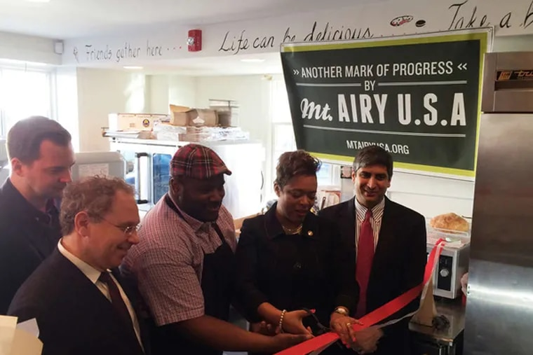 In February, Mt. Airy USA co-developed Little Jimmie's Bake House at 6616 Germantown Avenue., a historic renovation and Mt. Airy USA's first wave of investment in the blighted 6500–6700 blocks of Germantown Ave. Left to right: Brad Copeland, Mt. Airy USA board member Howard Treatman, Jimmie Reed, Councilwoman Cindy Bass, Anuj Gupta.