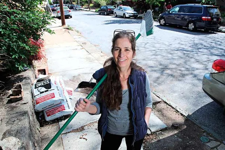 Celia Pretter stands on her street in Mt Airy where she did her best to clean up the whole block one day. ( Michael Bryant / Staff Photographer )