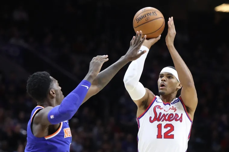 Tobias Harris of the Sixers shoots above Bobby Portis of the Knicks during the first half at the Wells Fargo Center.