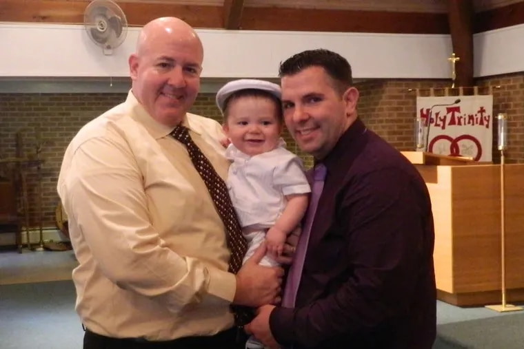 Jeff DeVault (left) and Herbie Sayles, with their son, Nathan.