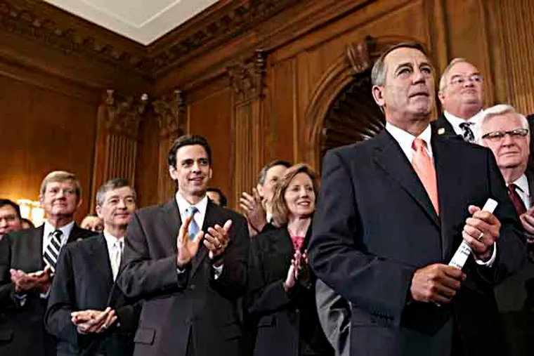 """Speaker of the House John Boehner, R-Ohio, right, is cheered as Republican members of the House of Representatives rally after passing a bill that would prevent a government shutdown while crippling the health care law that was the signature accomplishment of President Barack Obama's first term, at the Capitol in Washington, Friday, Sept. 20, 2013. The top Senate Democrat, Sen. Harry Reid, D-Nev., has pronounced the bill dead on arrival and calls the House exercise a """"waste of time."""" Applauding at left in front is Rep. Tom Graves, R-Ga., who led conservatives in persuading Boehner to accept a deal to link defunding the Affordable Care Act with the continuing resolution for government funding.  (AP Photo/J. Scott Applewhite)"""