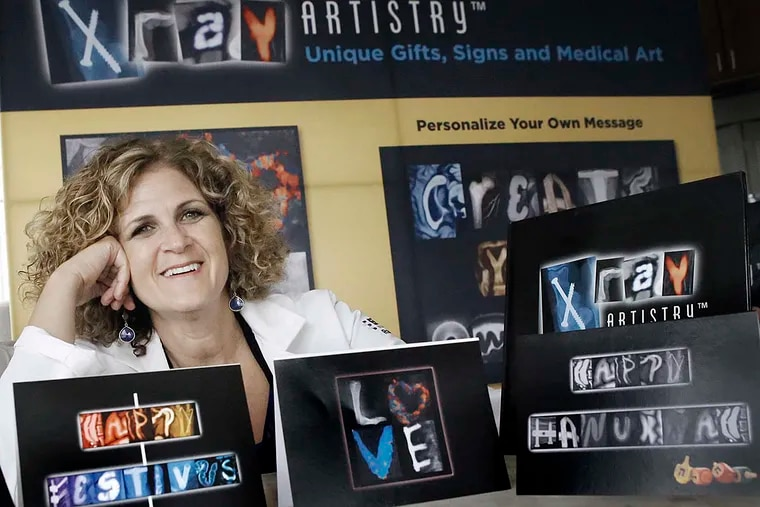 Radiologist Sue Summerton with examples of her art, based on X-rays and ultrasound images re-created by a graphic designer.
