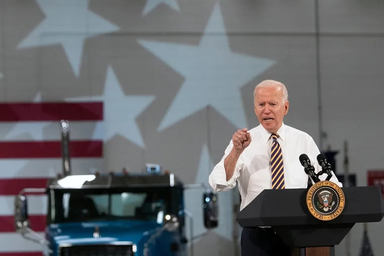 President Joe Biden speaks at the Mack Truck Lehigh Valley Operations in Macungie, Pa. Wednesday. Pennsylvania and New Jersey Democrats are counting on his infrastructure plan as a key selling point in next year's elections. Republicans blame the spending for rising inflation.