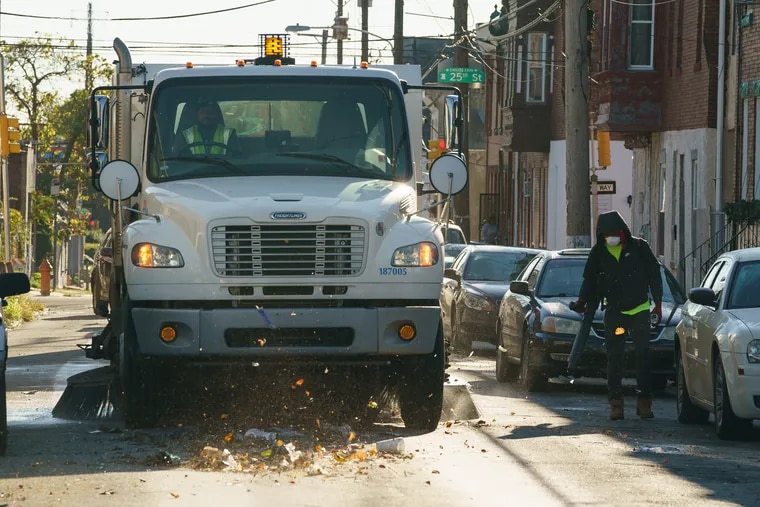 A street sweeping crew works near at 24th and York, in Philadelphia in October as part of the city's street cleaning pilot program. Mayor Jim Kenney promised that citywide street sweeping will be in place by 2023.