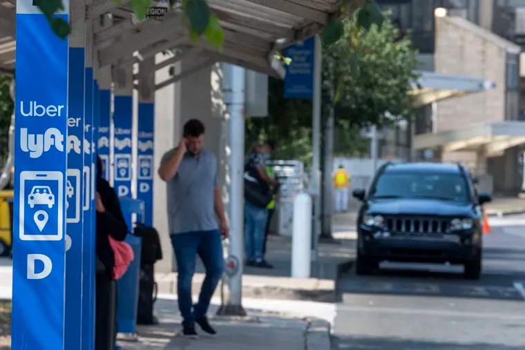 Arriving passengers at Philadelphia International Airport wait for the Uber or Lyft cars they've hailed. A shortage of drivers is pushing up the cost of rides for customers and, in some cases, wait times.