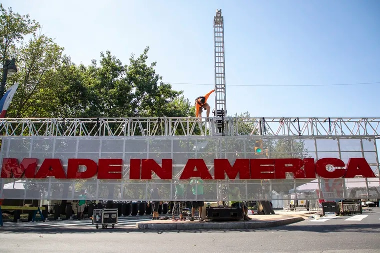 Construction workers put together the Made In America sign to be raised up before tomorrow's event this weekend on Friday, August 30, 2019.