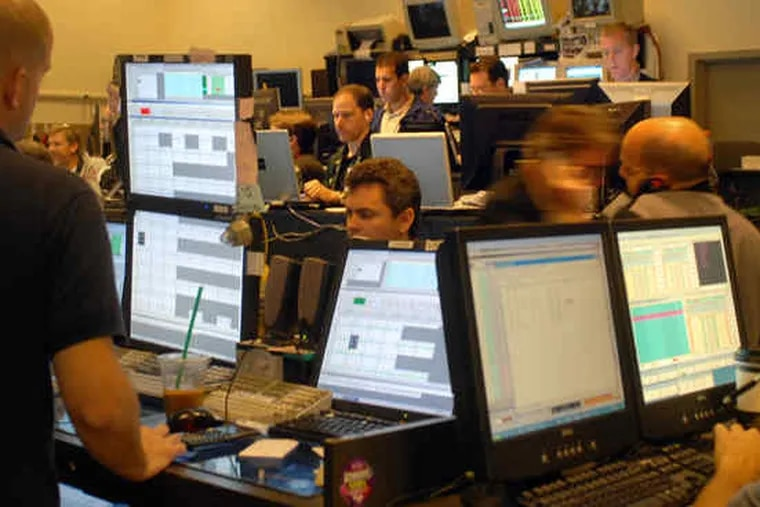 Traders at the old Philadelphia stock exchange, now owned by Nasdaq.