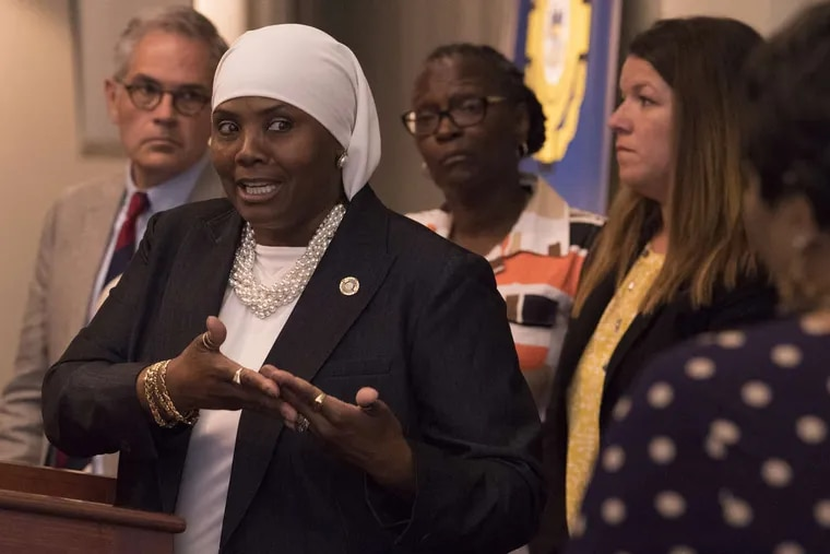 Movita Johnson-Harrell, supervisor of the Philadelphia District Attorney's Victim Witness Services, center, spoke at an Aug. 1 news conference about a new program for family members of homicide victims. Johnson-Harrell, a state House representative from Philadelphia, won a special election in March 2019 and is facing charges after prosecutors accused her of enriching herself by stealing money from a nonprofit she founded to serve the mentally ill and poor who were fighting addiction.