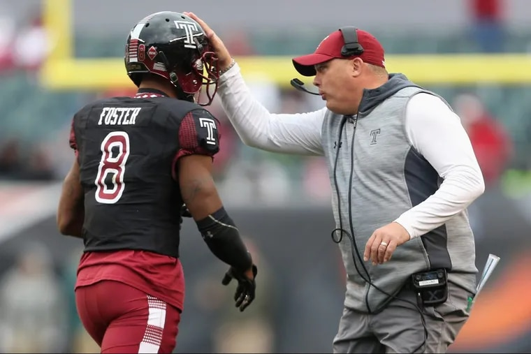 Temple head coach Geoff Collins talks with defensive back Artrel Foster (8) during a game against UCF at Lincoln Financial Field on Saturday, Nov 18, 2017. TIM TAI / Staff Photographer