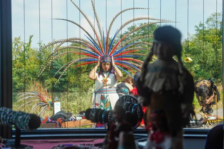 A member of the indigenous dance group Canpatlanezi adjusts their head dress at the Philly Indigenous People's Day celebration at the East Park Reservoir Discovery Center in Fairmount Park, October 7, 2021. Philly Indigenous People Day was established in 2011 as part of an initiative to help preserve and grow Indigenous culture in the city of Philadelphia. It is organized by the Philly Indigenous People's Day Committee, which is dedicated to maintaining, teaching and celebrating the culture of Indigenous people in Philadelphia, and around the world.