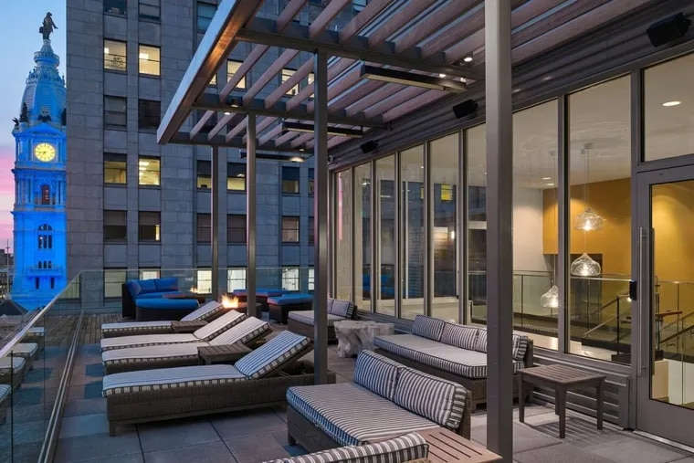 At the newly renovated Griffin apartments at Broad and Chestnut Streets, residents receive an array of amenities, including a rooftop deck with fire pits, outdoor grills and lounge seating. The Griffin is one building in the luxury market competing in Philadelphia's amenity arms race.