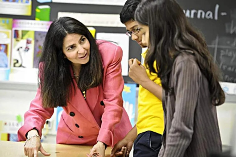 Margie Tavakalian works with students Akhil Vinod (center) and Siama Kamal on a classroom project at Beverly Hills Middle School in Upper Darby. RON TARVER / Staff Photographer