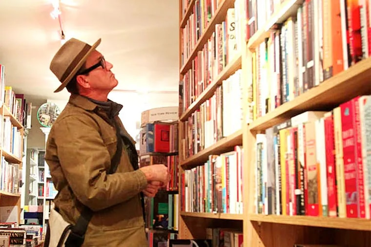 Chris Taylor shops books at Joseph A. Fox Booksellers.
