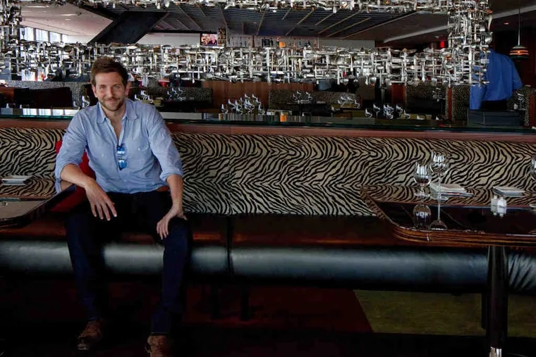 """Bradley Cooper , who grew up in Rydal, came back to the area - here he's at Two Liberty Place - to promote """"The Hangover: Part II."""""""