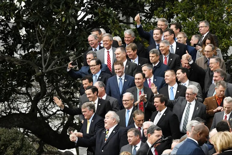 Republicans wave to President Donald Trump at an event to celebrate passage of the Tax Cuts and Jobs Act on Dec. 20. But when it comes to health care, there isn't much to cheer about.