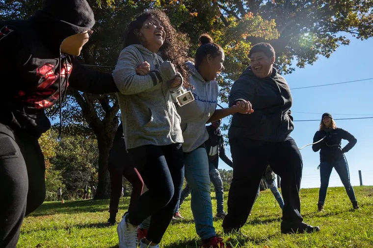 Students from Penn Treaty High School attempt to jump together in an Outward Bound team building exercise.