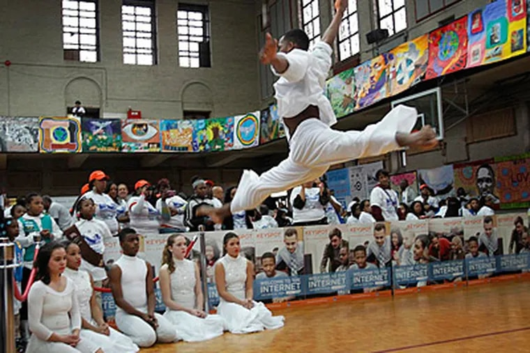 Dancer Jameel Hendricks, 17, of Philadelphia High School for the Creative and Performing Arts, leaps in the air during a performance Girard College's MLK Day of Service.