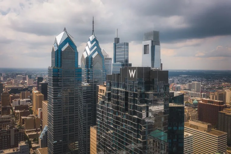 The tower housing a W and an Element by Weston hotel is pictured here in the foreground of other Center City highrises. The W is set to open after more than six years of construction.