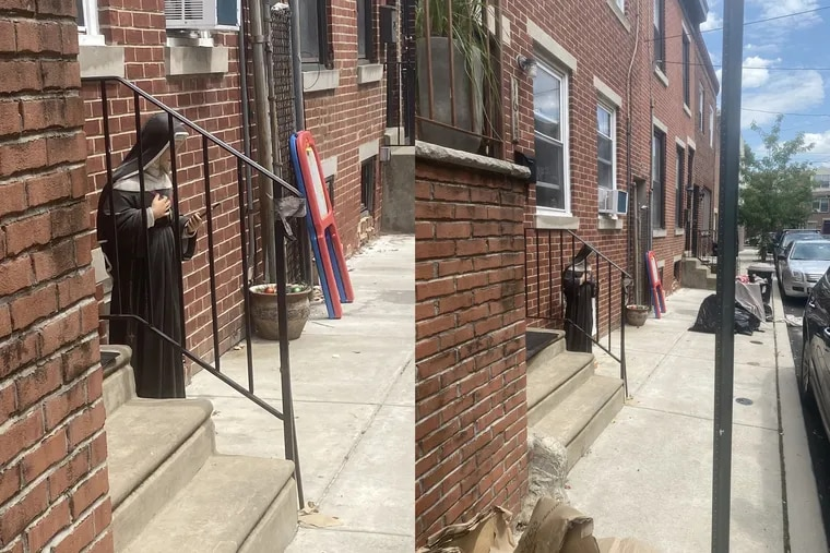 Statue of St. Rita of Cascia located on Webster Street earlier Saturday afternoon. It was returned by police to its shrine.