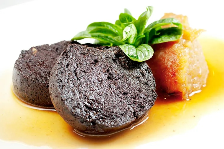 Boudin noir with pork blood sausage, pink lady apple compote and sherry vinegar sauce as served at Le Cheri, at the Art Alliance.