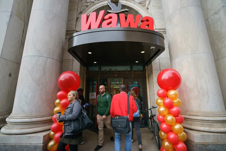 Customers exit the Wawa at 6th and Chestnut Streets during Wawa Day celebrations Thursday.