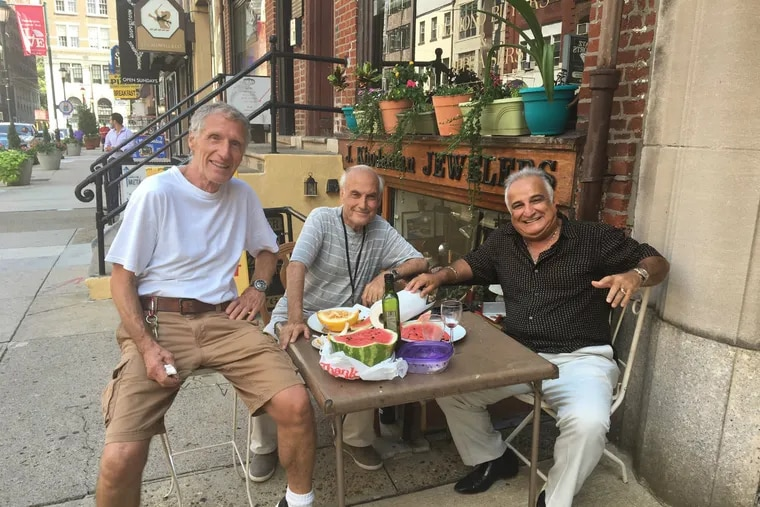On Jewelers Row, (from left) jewelry designer Jean Huffenus and merchants John Khodandian and Reuven Cohen share a lunch on the sidewalk in front of their Sansom Street shops.