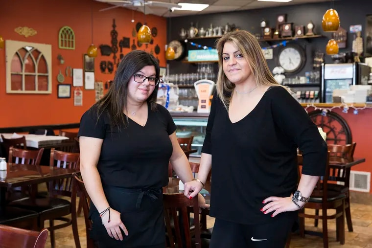 Yalli Avitan (right), co-owner of Judah Mediterranean Grille, and her sister Ariel say the thief waited until the staff was busy serving customers before swiping the tip jar.