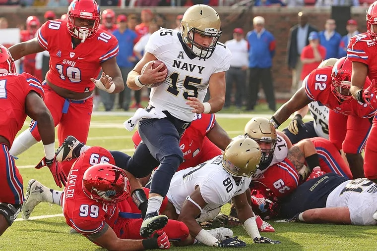 Navy quarterback Will Worth (15) cuts through the SMU defense to score a first-quarter touchdown at Ford Stadium in Dallas on Saturday, Nov. 26, 2016. Navy won, 75-31, as Worth ran for four scores and threw for another.