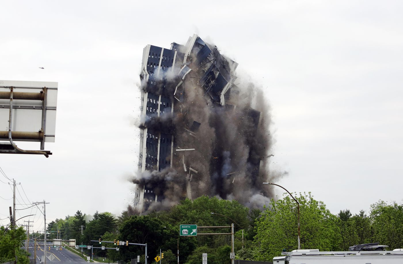 Martin Tower, former world headquarters of Bethlehem Steel, implodes Sunday, May 19, 2019 in Bethlehem, Pa. Crowds gathered to watch the demolition of the area's tallest building, a 21-story monolith that opened at the height of Bethlehem Steel's power and profitability but had stood vacant for a dozen years after America's second-largest steelmaker went out of business. (AP Photo/Jacqueline Larma)