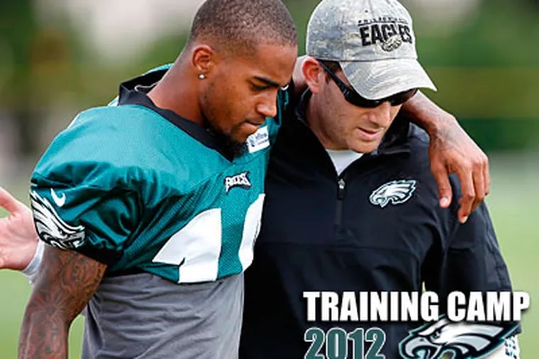 DeSean Jackson, left, talks with Eagles GM Howie Roseman before Sunday's afternoon practice. (David Maialetti/Staff Photographer)