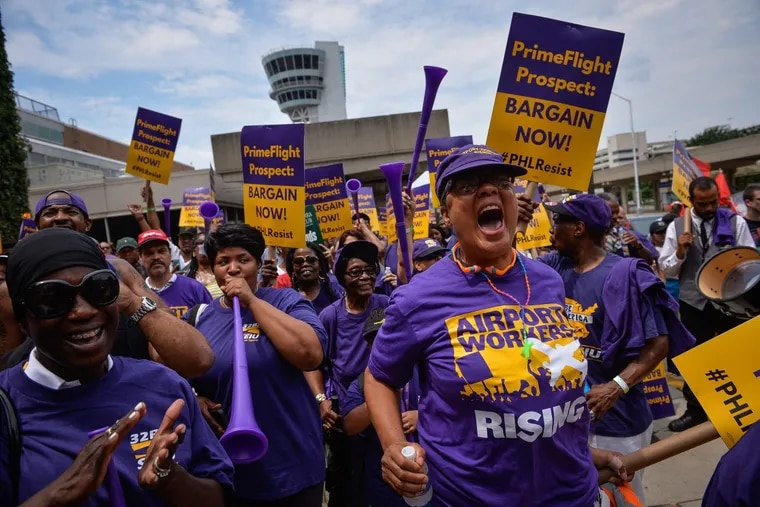 Philadelphia International Airport workers, part of the 32BJ labor union, marched outside of Terminal B/C to demand a contract with American Airlines subcontractors PrimeFlight and Prospect, at PHL International in July.