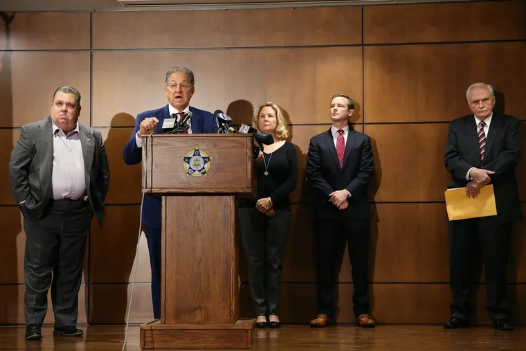 Attorney George Bochetto, second from left, in November announced a petition filed on behalf of Maureen Faulkner, seen in background, in the Pennsylvania Supreme Court in the case of Mumia Abu-Jamal, who was convicted of the 1981 murder of Faulkner's husband, Police Officer Daniel Faulkner. At left was FOP President John McNesby; second from right was Jack O'Neill, another attorney who has been helping Faulkner; and at far right was Joseph McGill, the prosecutor who handled Abu-Jamal's trial.