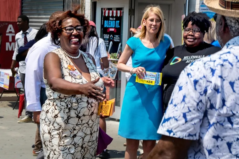 Tracey Gordon (left) campaigns in Germantown on Sunday. She defeated Register of Wills Ron Donatucci in the Democratic primary Tuesday. He has been the register of wills since 1980.