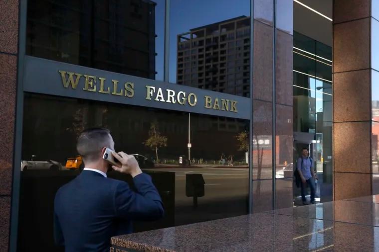 A pedestrian walks past a Wells Fargo bank in downtown Los Angeles.