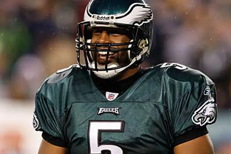 Donovan McNabb and the Eagles will need help plus a win over the Cowboys Sunday to have a chance at the postseason. (File photo)
