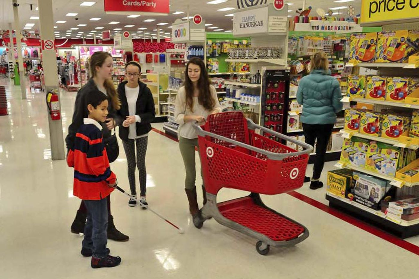 Blind children shop for Christmas with Lions Club and teens' help