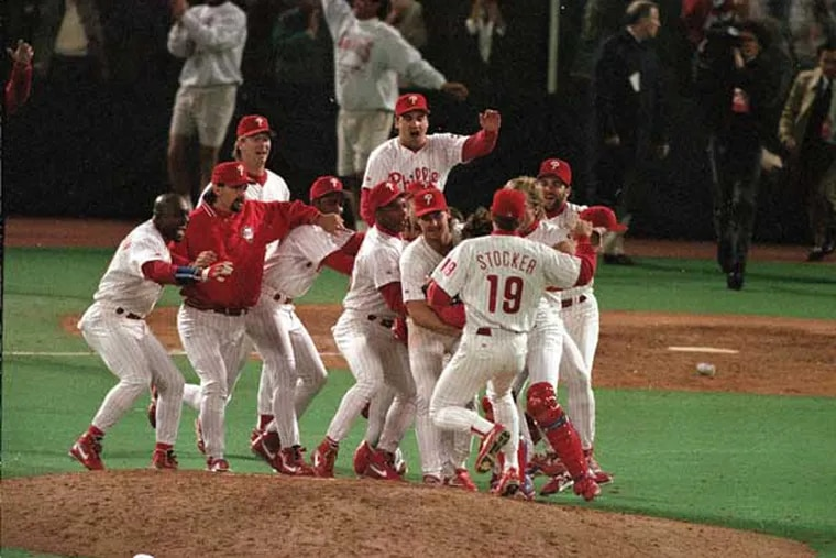 Phillies relief pitcher Mitch Williams is surrounded by teammates after striking out Atlanta's Bill Pecota for the final out in the Phillies' 6-3 win for the National League title on Oct. 13, 1993.