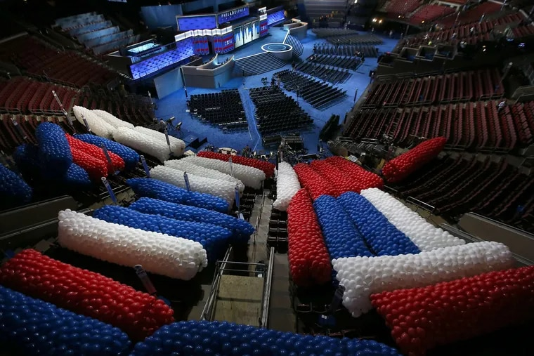 Balloons for the final night of the 2016 Democratic National Convention wait to be lifted to the ceiling during preparations at the Wells Fargo Center.