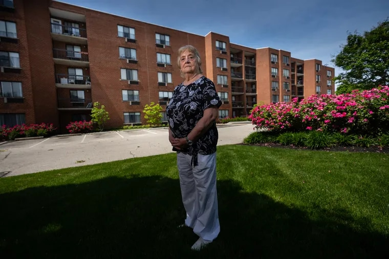 Anna Marie Bresnan, 84, an independent living resident, stands outside Philadelphia Protestant Home, her retirement community in Northeast Philadelphia.