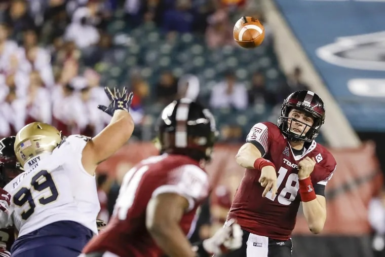 Temple quarterback Frank Nutile throws the football to Temple tight end Kenny Yeboah during the fourth-quarter against Navy on Thursday, November 2, 2017 in Philadelphia. YONG KIM / Staff Photographer