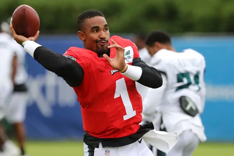 Eagles quarterback Jalen Hurts (1) throws the ball before the start of training camp at the NovaCare Complex on Aug. 4.