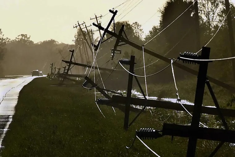Power lines fell as a result of Hurricane Irma's winds along Corkscrew Road near Estero, Fla.