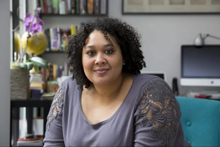 """Writer and activist Crystal Cheatham, shown here in her home office in Philadelphia. Cheatham is the developer of """"Our Bible,"""" a new app aimed at LGBTQ people of faith and progressive Christians."""