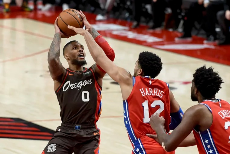 Damian Lillard, left, and the Trail Blazers got the last word in on Tobias Harris, Joel Embiid and the Sixers.
