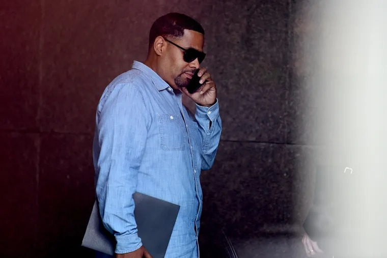 Jeffrey Blackwell, step-grandson of Councilwoman Jannie Blackwell, talks on a phone inside the lobby of the federal courthouse in Philadelphia after he was charged with 13 counts of bribery and tax fraud on Thursday, Sept. 12, 2019.
