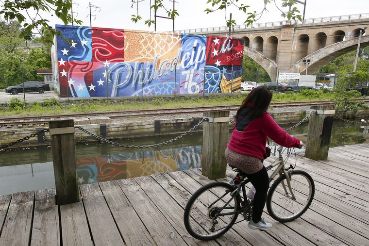 A popular Manayunk mural was replaced by an ode to the Sixers. No one told the artist.