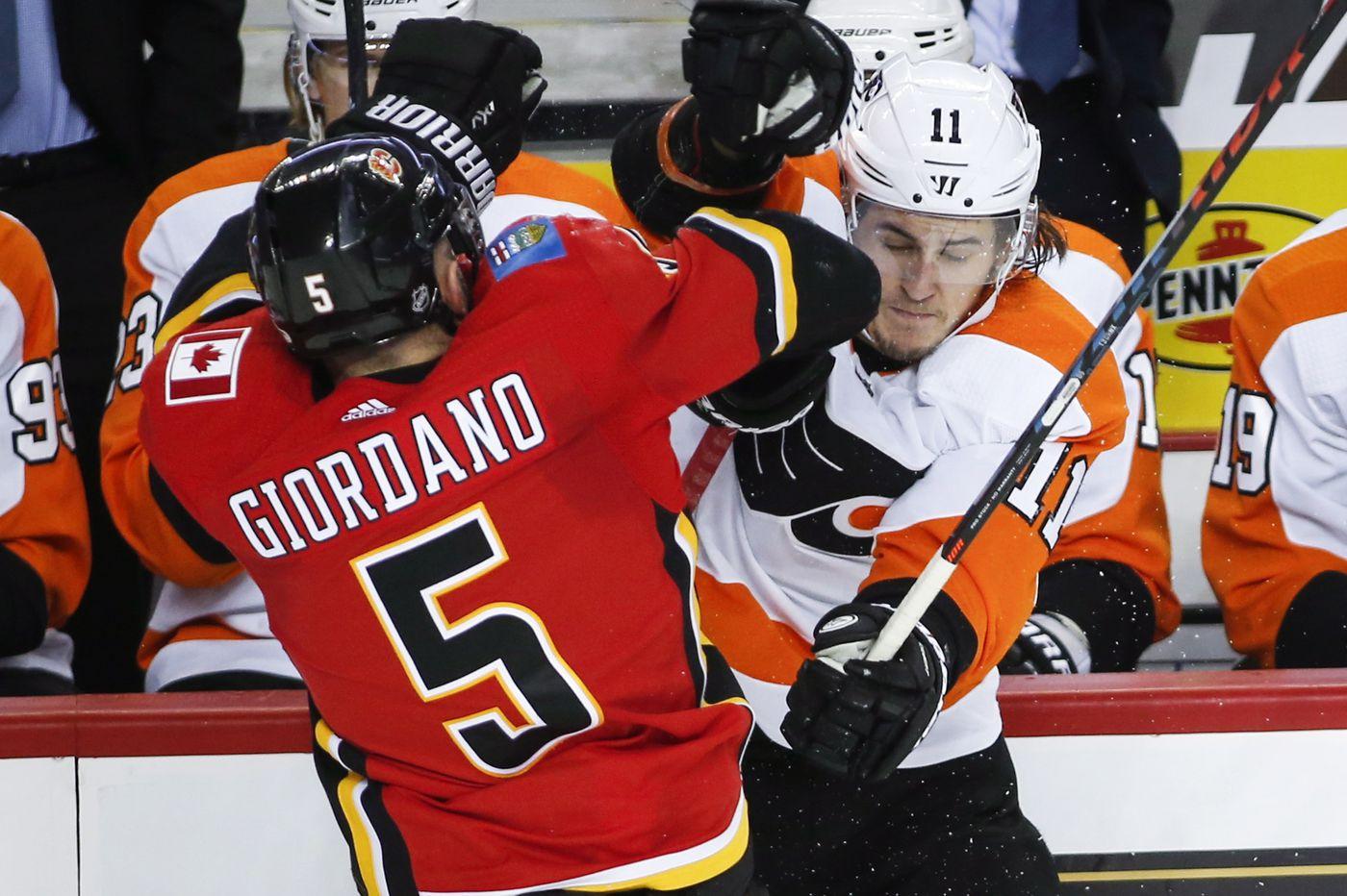 Three late Calgary goals stun Flyers, 6-5