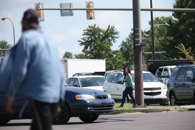 Shareena Johnson walks across on Roosevelt Boulevard at Bustleton Avenue in Northeast Philadelphia. Ten pedestrians were killed on the Boulevard, according to police data.
