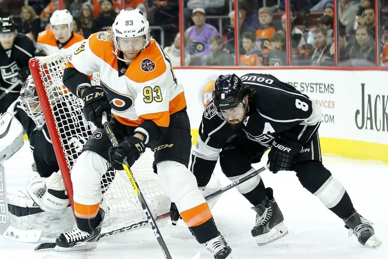 Jake Voracek skating with the puck past Kings  defenseman Drew Doughty in a game last season.