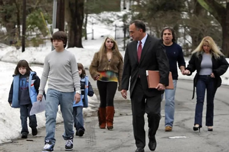 Blake Robbins, front, walks with his family, including mother, Holly, and father, back right. Also shown is the family attorney, Mark S. Haltzman,  front right. (Ed Hille / Staff Photographer)